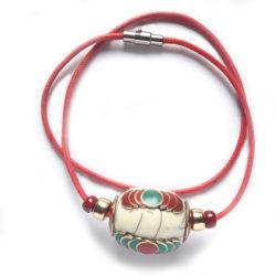 collier nepalais avec motifs en laiton