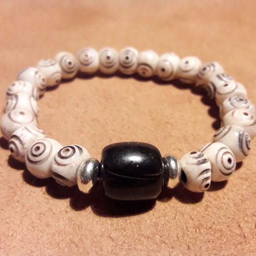 Bracelet crotale noir et blanc en os , fait main