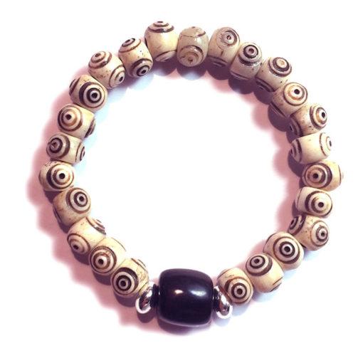 Bracelet crotale blanc œil de bouddha avec olive noire en corne